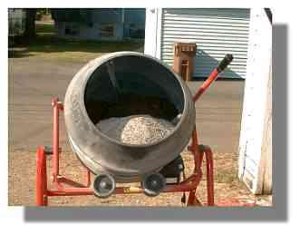 A cement mixer will save you a lot of time mixing up the soil each year... especially when you get to about 30 tubs or so.